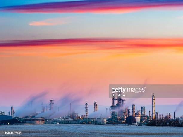 sunset view of refinery complex - regina saskatchewan stock pictures, royalty-free photos & images