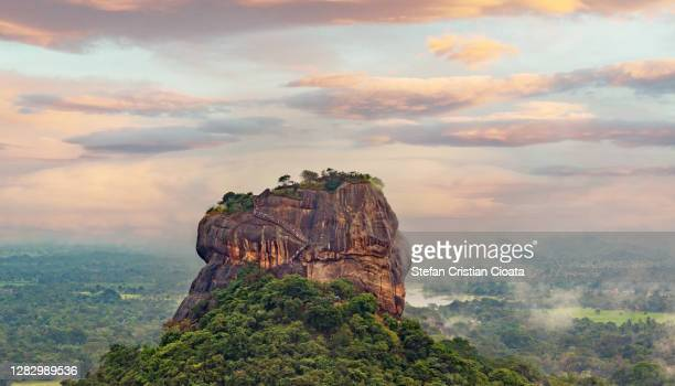 sunset view of sigiriya rock from pidurangala rock in sri lanka - palace stock pictures, royalty-free photos & images