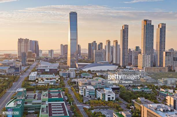 sunset view of songdo international business district - songdo ibd stock pictures, royalty-free photos & images