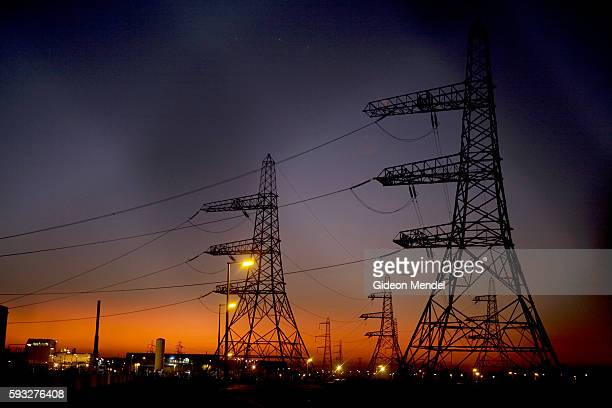 A sunset view of the electric pylons taking electricity from the Dungeness B nuclear power station into the national grid This is an gascooled...