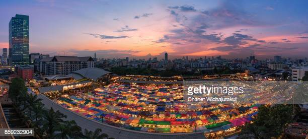 sunset view of the train night market ratchada. train night market ratchada, also known as talad nud rod fai, is a new flea market place at bangkok. - nud stock photos and pictures