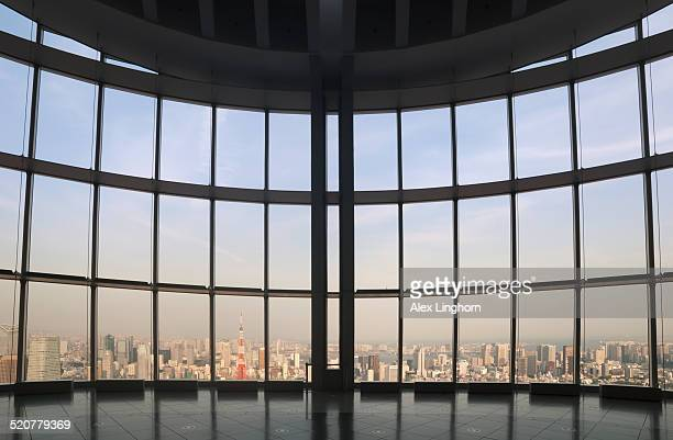 sunset view of tokyo from modern glass observatory - roppongi hills stock pictures, royalty-free photos & images