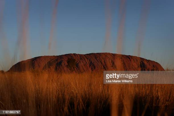 Sunset view of Uluru as seen from the designated viewing area on August 13, 2019 in the Uluru-Kata Tjuta National Park, Australia. The Uluru-Kata...