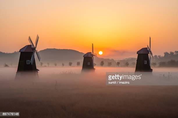 Sunset view of Windmill with Sea Fog in Soraepogu pier