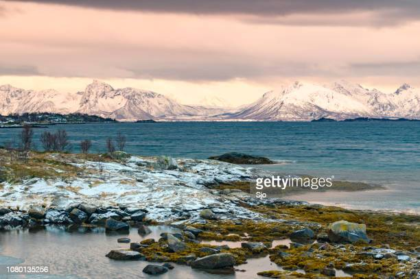 Sunset view on Hadseløya island from Langøya on the Vesteralen in Northern Norway during a cold winter sunset.