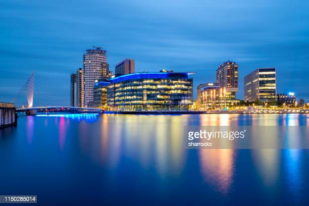 sunset view over media city at salford quays in manchester, united kingdom - salford stock pictures, royalty-free photos & images