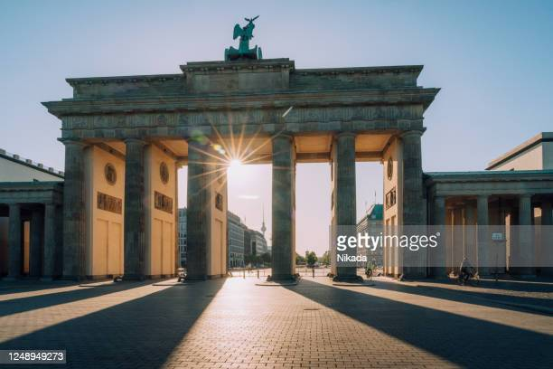 sunset  view to brandenburg gate -  berlin, germany - german culture stock pictures, royalty-free photos & images