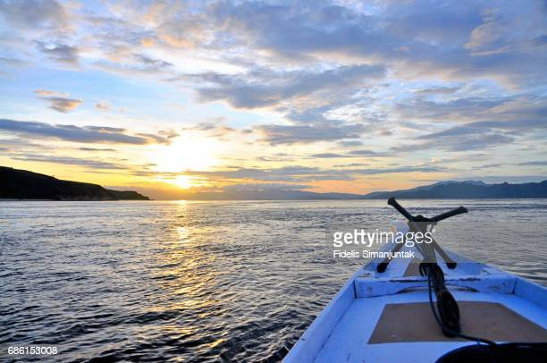 Sunset viewed from a traditional boat at Flores Sea near Komodo National Park area in Indonesia
