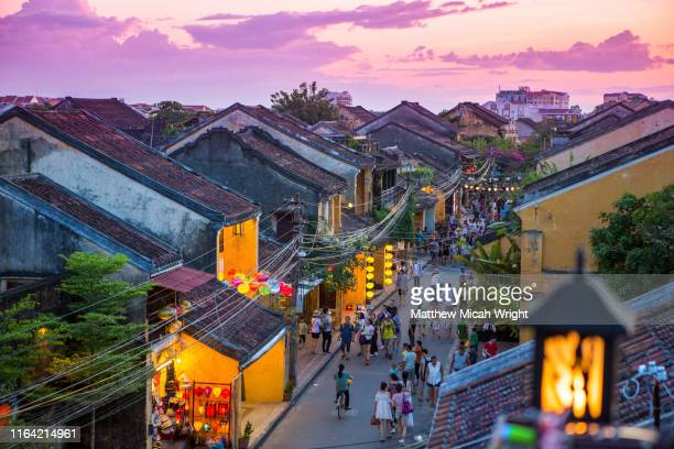 sunset views overlooking hoi an's downtown colonial and historic center from a rooftop perspective. - vietnam stock-fotos und bilder