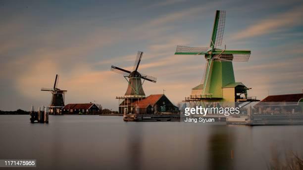 sunset windmill - dezember stock-fotos und bilder