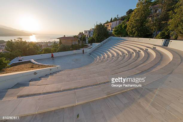 Sunset with a modern theater in the foreground Shot on the Greek island of Samos the town of Vathi