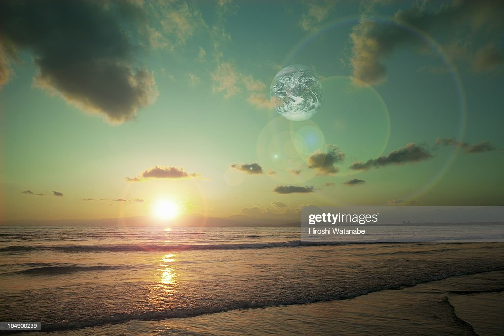 Sunset with another Earth : Stock Photo