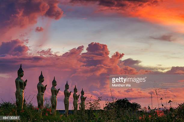 sunset with buddha statue - hua hin thailand stock pictures, royalty-free photos & images