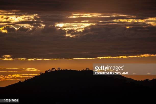 sunset with dark clouds, evening light, at paguera or peguera, majorca, balearic islands, spain - {{asset.href}} stock pictures, royalty-free photos & images