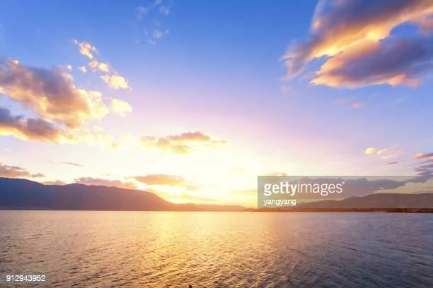 sunset with dramatic clouds on the tropical beach - morning stock pictures, royalty-free photos & images