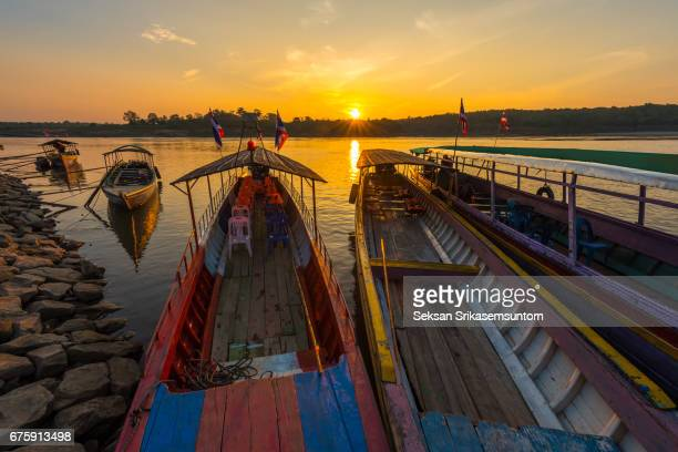 Sunset with longtail boats