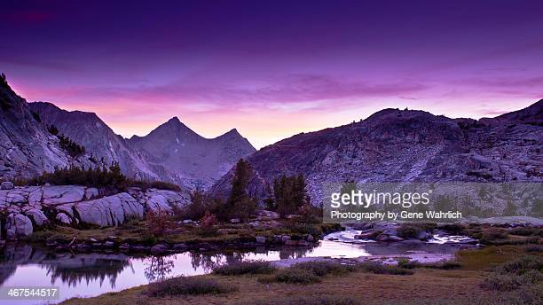sunset with purple sky, lake and mountains - john muir trail stock photos and pictures