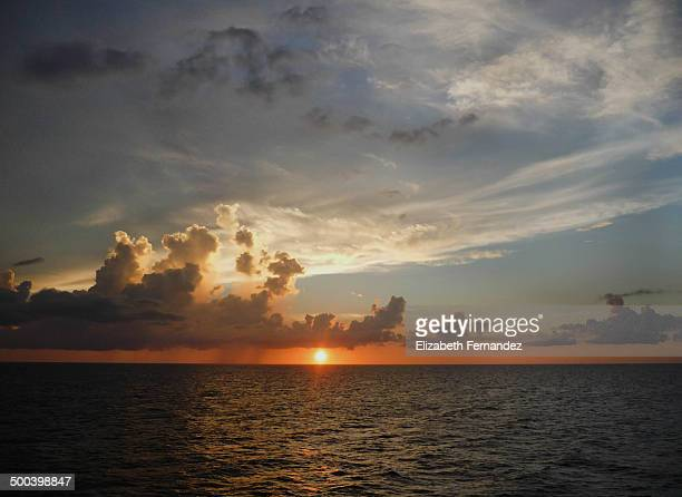 Sunset with rain in the Caribbean Sea
