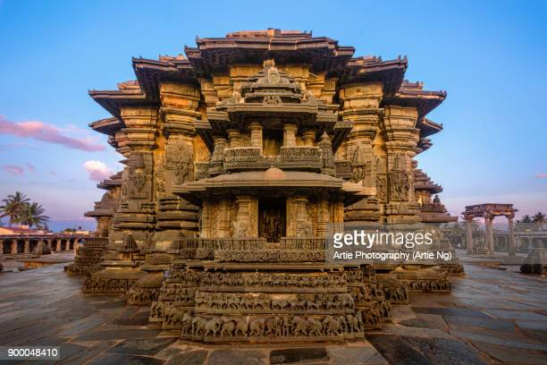sunset with the chennakeshava (keshava, kesava or vijayanarayana) temple of belur, hassan, karnataka, india - karnataka stock pictures, royalty-free photos & images