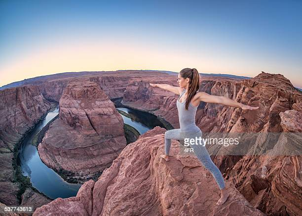 sunset yoga, feeling nature - horseshoe bend - lake powell stock pictures, royalty-free photos & images