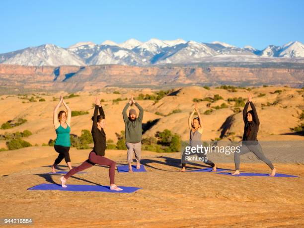 sunset yoga in moab utah - images foto e immagini stock