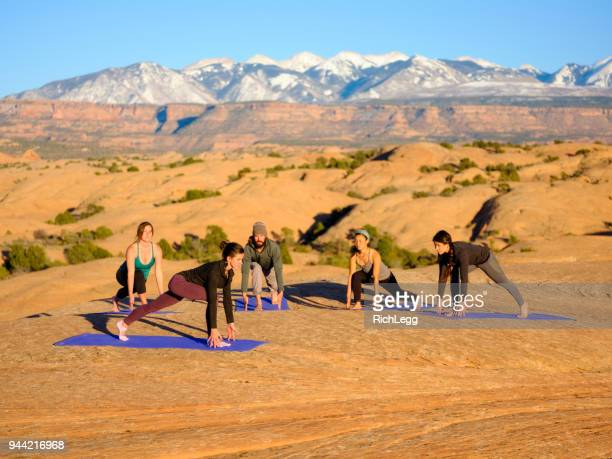 sunset yoga in moab utah - rich_legg stock photos and pictures