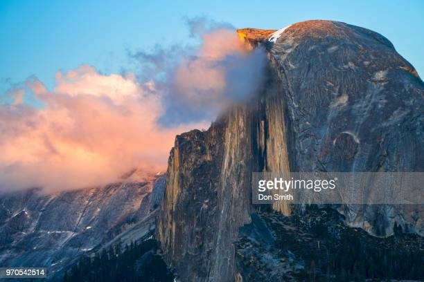 sunset-lit clouds and half dome - don smith stock pictures, royalty-free photos & images