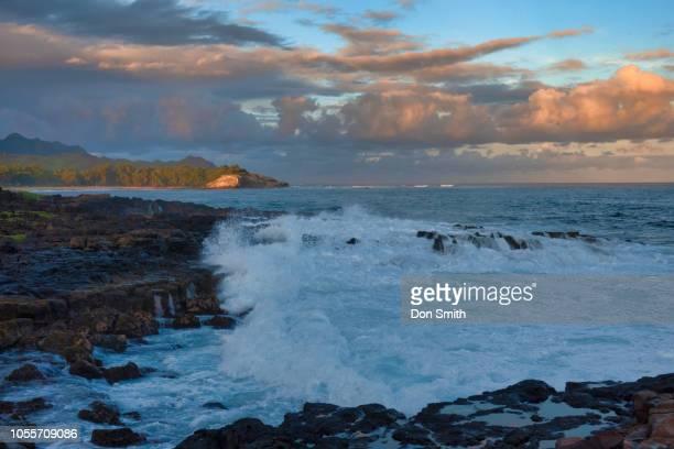 sunset-lit clouds over shipwreck beach, kauai - don smith stockfoto's en -beelden