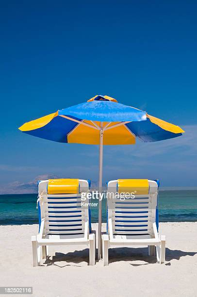 sunshade and two chairs at beach