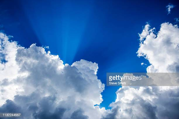 sunshine and clouds in sky - cumulonimbus stock pictures, royalty-free photos & images