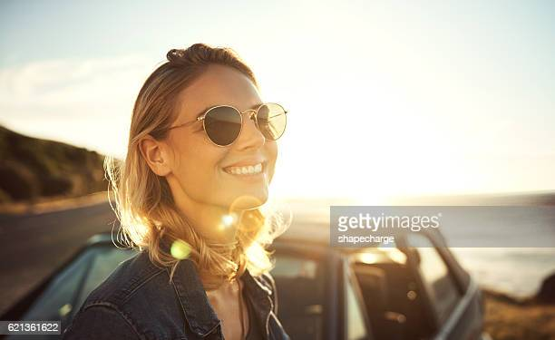 sunshine and smiles - sunglasses stock pictures, royalty-free photos & images