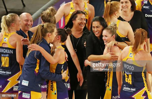 Sunshine Coast Lightning coach Noeline Taurua and her players celebrate after winning the Super Netball Major Semi Final match between the Vixens and...