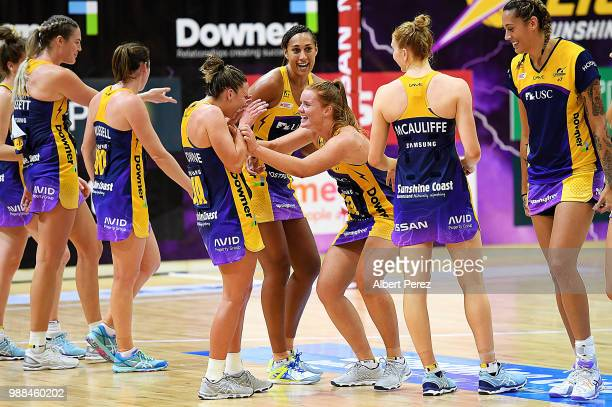 Sunshine Coast Lightning players celebrate their win over Queensland Firebirds during the round nine Super Netball match between the Lightning and...