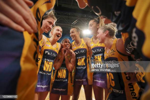 Sunshine Coast Lightning players huddle together after their win Super Netball Grand Final match between the the Fever and the Lightning on August 26...