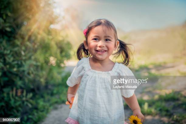 sunshine girl - toddler outdoors - mixed race person stock pictures, royalty-free photos & images