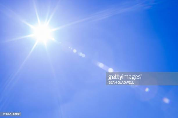 sunshine lens flare - clear sky stock pictures, royalty-free photos & images