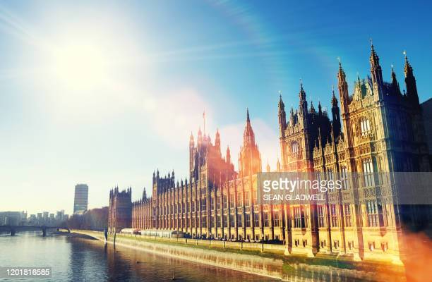 sunshine over houses of parliament - democracy stock pictures, royalty-free photos & images