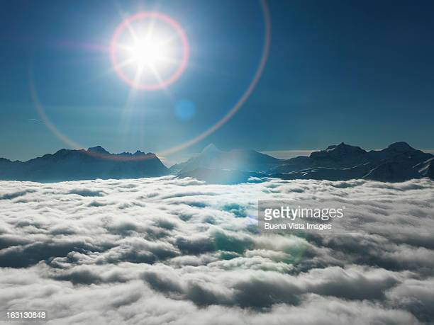 Sunshine over mountains  emerging from  fog