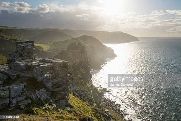 sunshine over the valley of the rocks near lynton in exmoor national park. - lynton stock pictures, royalty-free photos & images