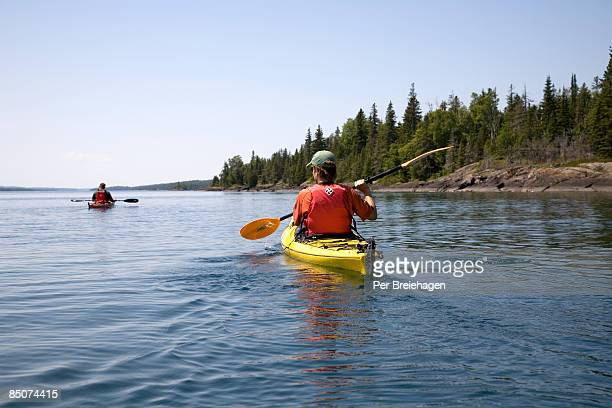sunshine paddle in rock harbor - michigan stock pictures, royalty-free photos & images