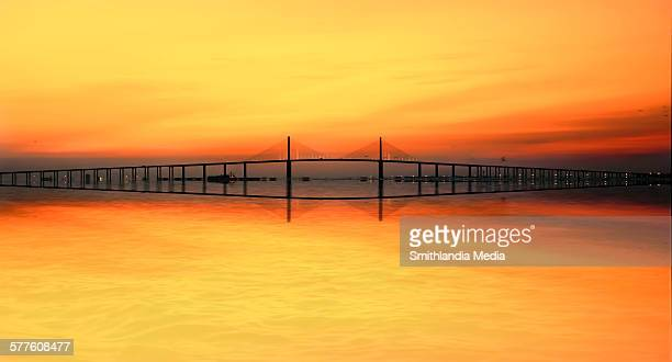 sunshine skyway bridge sunrise with reflection - sunshine skyway bridge stock photos and pictures