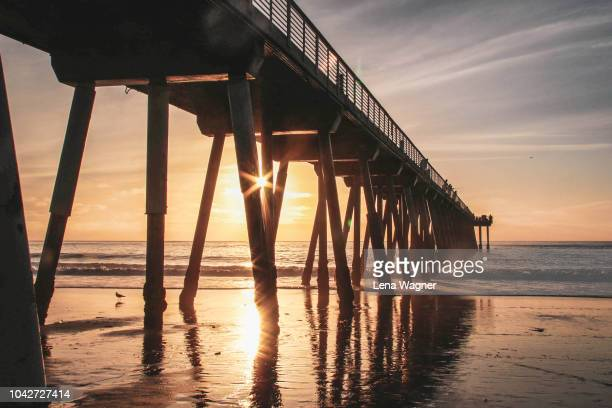 sunshine through the pier - hermosa beach stock pictures, royalty-free photos & images