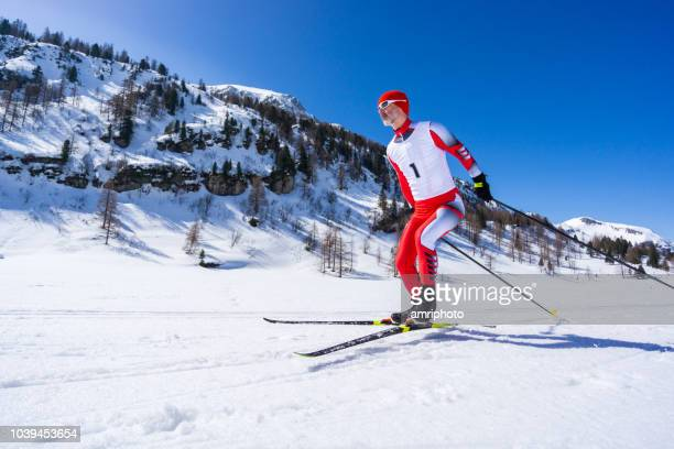 sunshine winter mountains cross country skier skating on track - ski racing stock pictures, royalty-free photos & images