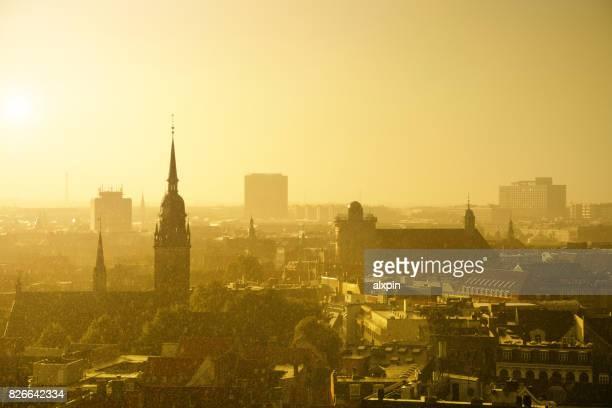 sunshower in copenhagen - irish round tower stock photos and pictures