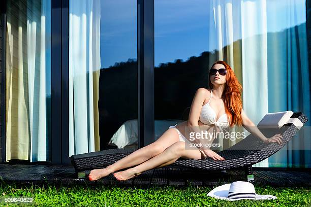 suntanning woman on lounge chair
