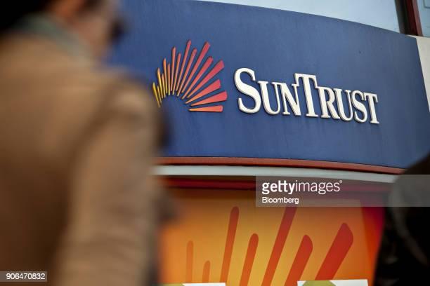 SunTrust Banks Inc signage is displayed outside an automatic teller machine in Washington DC US on Thursday Jan 11 2018 SunTrust Banks Inc is...