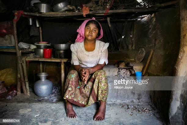 COX'S BAZAR BANGLADESH DECEMBER 02 Sunuara poses for a photo on December 2 2017 in Cox's Bazar Bangladesh She fled to Bangladesh shortly after the...