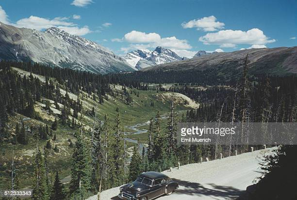Sunwapta Pass in the Canadian Rockies in Alberta Canada circa 1960 It marks the boundary between the Banff and Jasper National Parks