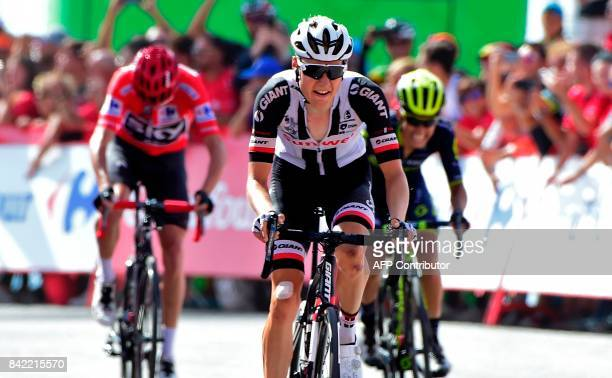 Sunweb's Dutch cyclist Wilco Kelderman crosses the finish line of the 15th stage of the 72nd edition of 'La Vuelta' Tour of Spain cycling race a 1294...