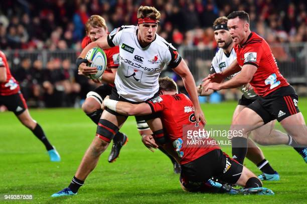 TOPSHOT Sunwolves' James Moore is tackled by Crusaders' Mitchell Drummond during the Super Rugby match between the Canterbury Crusaders of New...